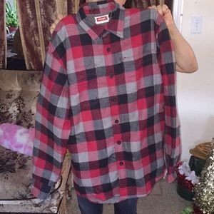 Plaid coat with fur on the inside to keep warm